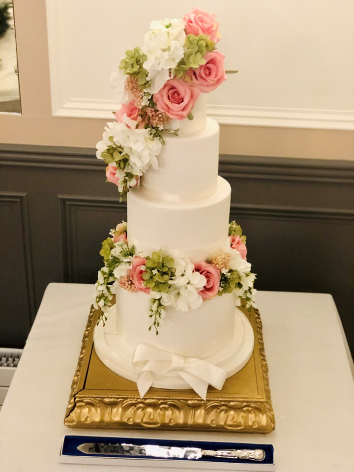 Wedding cake on gold stand