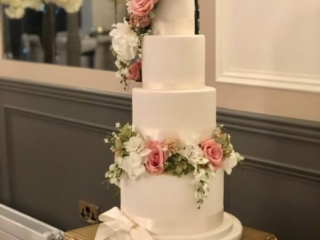 Wedding cake on a gold stand