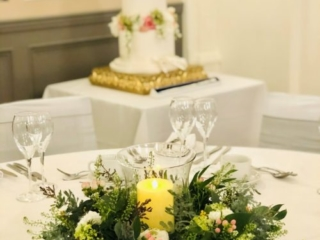 Table centrepiece with candles at a wedding