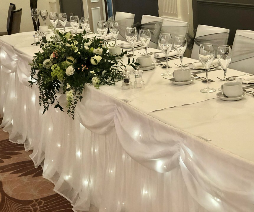 Glasses on top table at a wedding reception