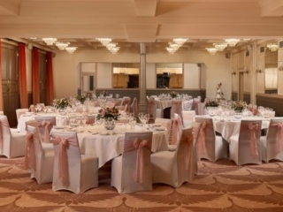 The Coach Room at Bedford Swan Hotel laid out for the wedding breakfast